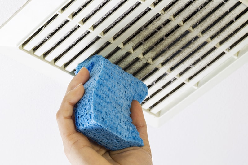 blue sponge cleaning dirty air duct